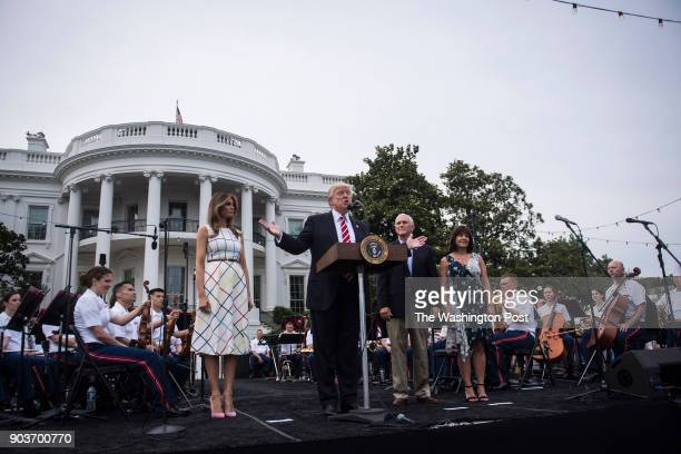 President Donald Trump speaks with First Lady Melania Trump Vice President Mike Pence and his wife Karen during the Congressional Picnic on the South...
