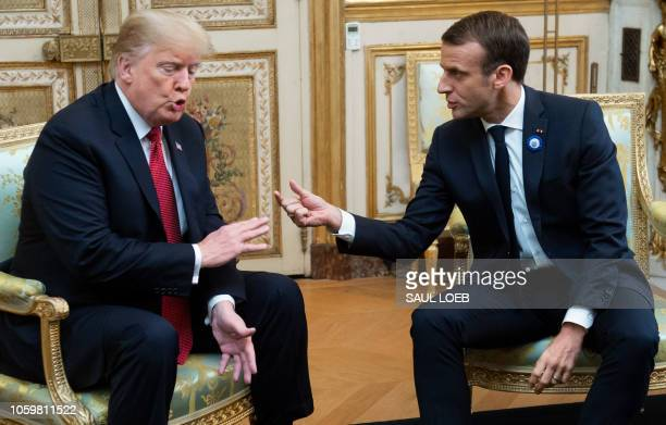President Donald Trump speaks with French president Emmanuel Macron prior to their meeting at the Elysee Palace in Paris on November 10 on the...