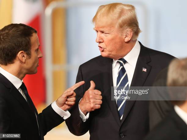 President Donald Trump speaks with French President Emmanuel Macron after posing for the family photo during the G20 summit on July 7 2017 in Hamburg...