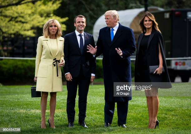 President Donald Trump speaks with French President Emmanuel Macron, his wife Brigitte Macron and first lady Melania Trump as they depart for Mount...