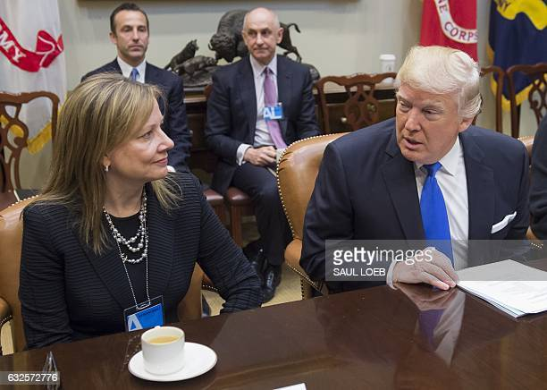 US President Donald Trump speaks with General Motors CEO Mary Barra during a meeting with automobile industry leaders in the Roosevelt Room of the...