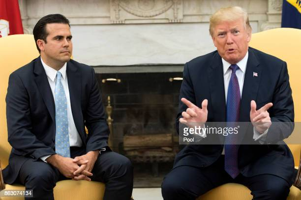 President Donald Trump speaks with Governor Ricardo Rossello of Puerto Rico during a meeting in the Oval Office at the White House on October 19 2017...