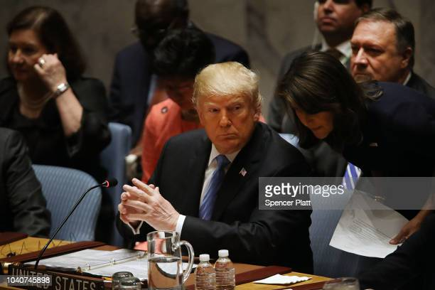 President Donald Trump speaks with his United Nations ambassador Nikki Haley while chairing a United Nations Security Council meeting on September 26...