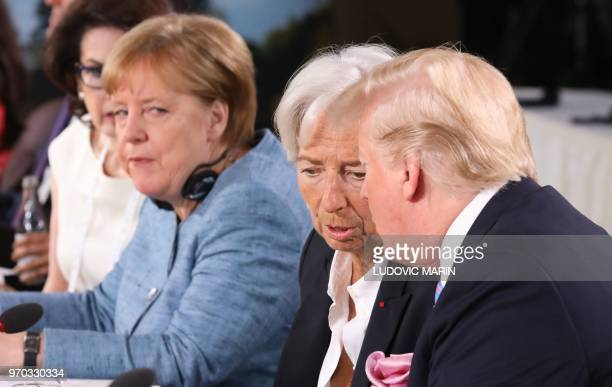 US President Donald Trump speaks with International Monetary Fund Managing Director Christine Lagarde as they attend the Gender Equality Advisory...