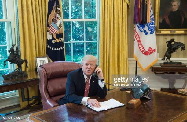 US President Donald Trump speaks with Irish Prime Minister Leo Varadkar to congratulate him on his recent election victory in the Oval Office at the...