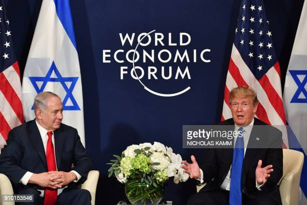 President Donald Trump speaks with Israel's Prime Minister Benjamin Netanyahu during a bilateral meeting on the sidelines of the World Economic Forum...
