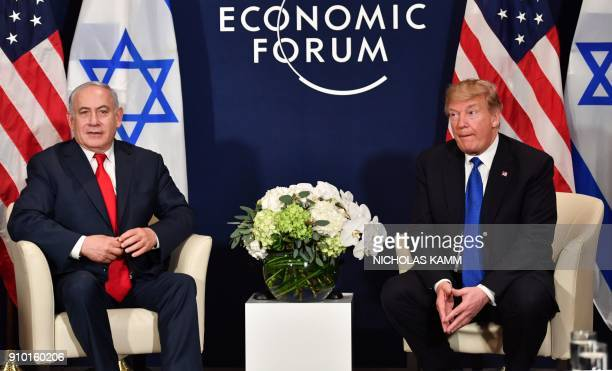 US President Donald Trump speaks with Israel's Prime Minister Benjamin Netanyahu during a bilateral meeting on the sidelines of the World Economic...