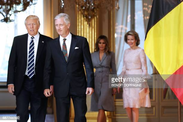 President Donald Trump speaks with King Philippe - Filip of Belgium as US First Laday Melania Trump walks with Queen Mathilde of Belgium during a...