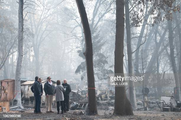 US President Donald Trump speaks with Lieutenant Governor of California Gavin Gavin Newsom Paradise Mayor Jody Jones Governor of California Jerry...