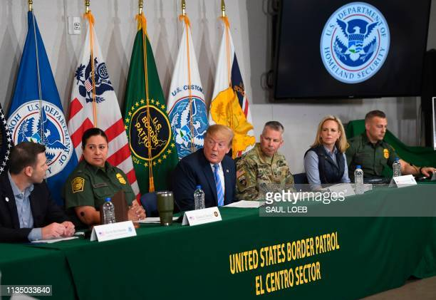 US President Donald Trump speaks with members of the Border Patrol as US Secretary of Homeland Security Kirstjen Nielsen looks on during a press...