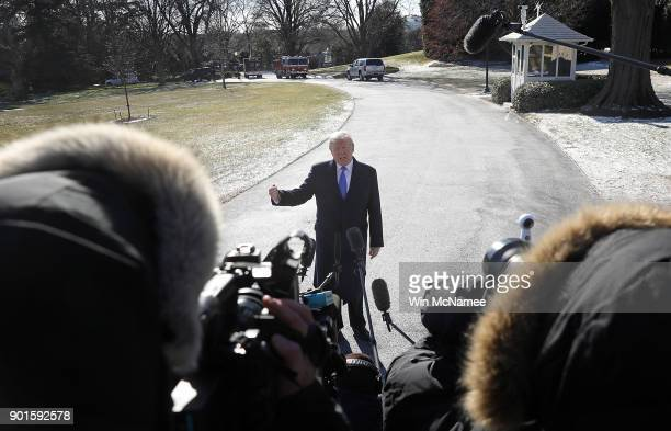 S President Donald Trump speaks with members of the press while departing the White House January 5 2018 in Washington DC Trump is scheduled to spend...