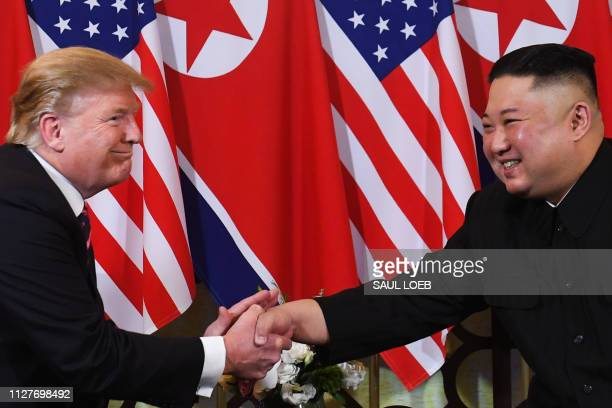 US President Donald Trump speaks with North Korea's leader Kim Jong Un during a meeting at the Sofitel Legend Metropole hotel in Hanoi on February 27...