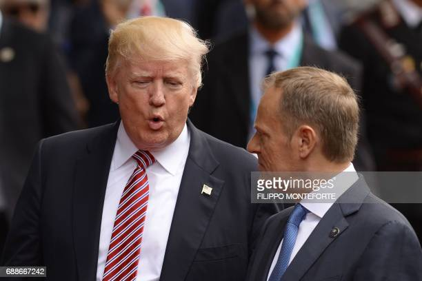 President Donald Trump speaks with President of the European Council Donald Tusk on their way to the Hotel San Domenico during the Heads of State and...