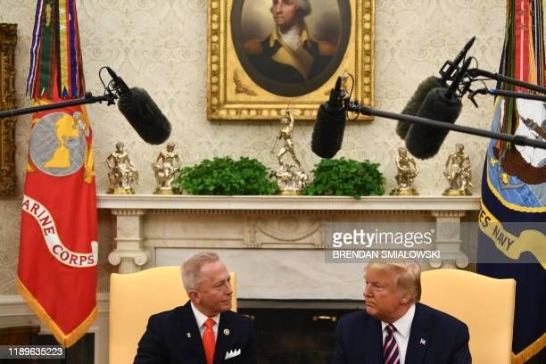 US President Donald Trump speaks with Rep Jeff Van Drew DNJ in the Oval Office at the White House on December 19 2019 in WashingtonDC Trump brought...