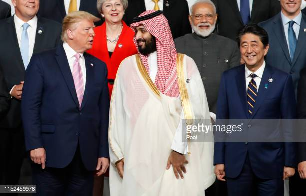 President Donald Trump speaks with Saudi Arabia's Crown Prince Mohammed bin Salman during a family photo session at G20 summit on June 28, 2019 in...
