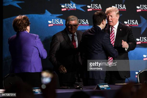 US President Donald Trump speaks with Senator Marco Rubio a Republican from Florida second right before the start of a roundtable discussion on tax...
