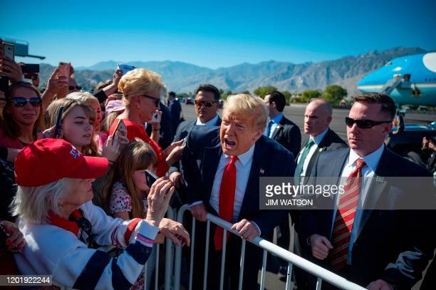 President Donald Trump speaks with supporters as he arrives in Palm Springs, California, on February 19, 2020.