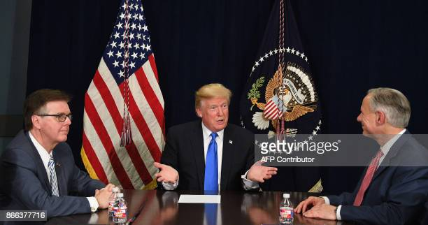 US President Donald Trump speaks with Texas Governor Greg Abbott and Lieutenant Governor Dan Patrick during a briefing on hurricane relief efforts in...
