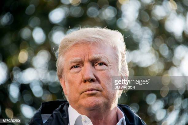 US President Donald Trump speaks with the press before boarding Marine One on the South Lawn of the White House in Washington DC October 3 2017 en...