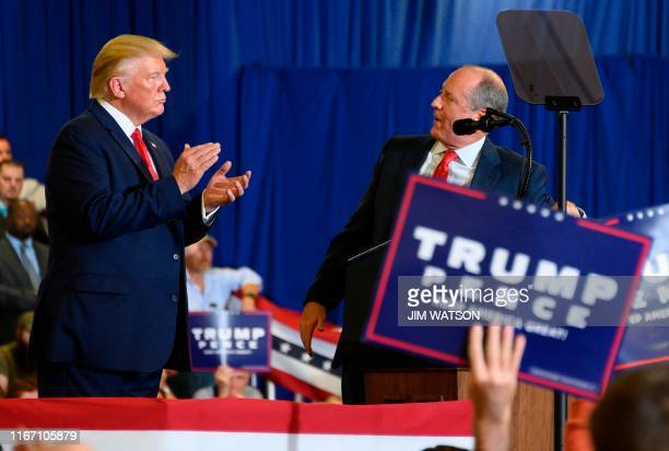 """President Donald Trump speaks with US Congressional candidate Dan Bishop during a """"Keep America Great"""" campaign rally at The Crown Arena in..."""