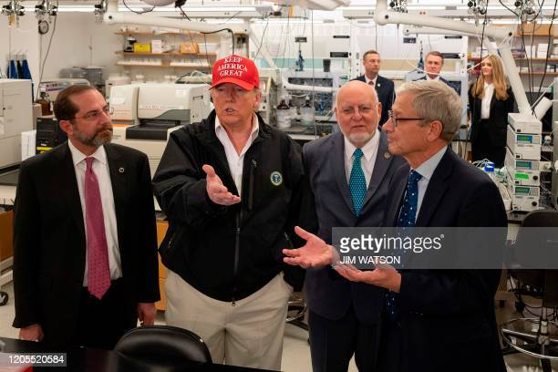 President Donald Trump speaks with US Health and Human Services Secretary Alex Azar , CDC Director Dr. Robert Redfield and CDC Associate Director for...