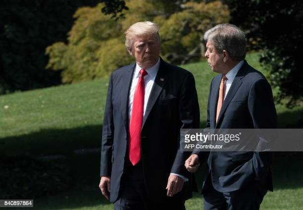 US President Donald Trump speaks with US Republican Senator from Missouri Roy Blunt as they depart the White House in Washington DC on August 30 2017...