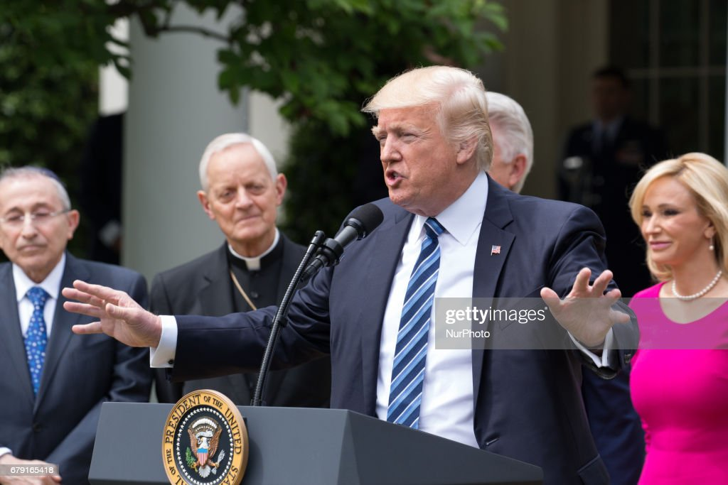 President Donald Trump spoke, with Rabbi Marvin Hier, Cardinal Donald Wuerl, Pastor Jack Graham, and Pastor Paula White at his side, at the National Day of Prayer ceremony, in the Rose Garden of the White House, On Thursday, May 4, 2017.