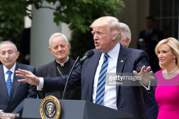 President Donald Trump spoke with Rabbi Marvin Hier Cardinal Donald Wuerl Pastor Jack Graham and Pastor Paula White at his side at the National Day...