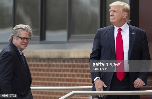 US President Donald Trump stands alongside Chief Strategist Stephen Bannon upon arrival at SnapOn Tools in Kenosha Wisconsin April 18 prior to...