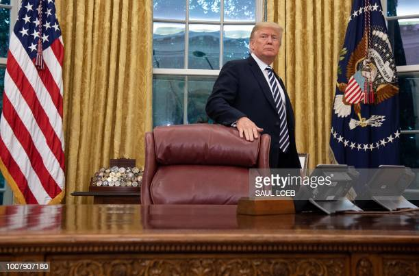 US President Donald Trump stands behind the Resolute Desk after Robert Wilkie was swornin as Secretary of Veterans Affairs in the Oval Office of the...