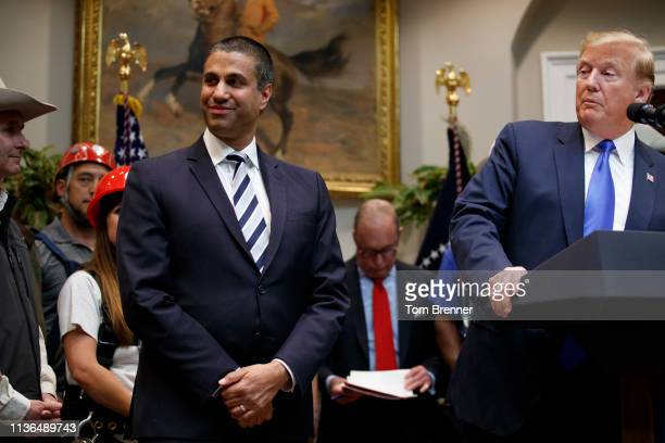 President Donald Trump stands beside FCC Chair Ajit Pai, left, before delivering remarks on 5G deployment in the United States on April 12, 2019 in...