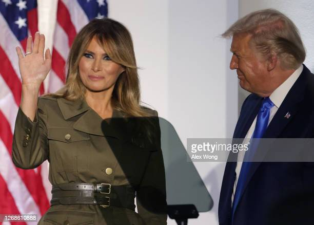 President Donald Trump stands by first lady Melania Trump as she waves after she addressed the Republican National Convention from the Rose Garden at...