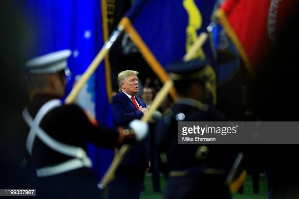 S President Donald Trump stands for the national anthem prior to the College Football Playoff National Championship game between the Clemson Tigers...
