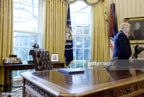 S President Donald Trump stands in the Oval Office after speaking about trade at the White House March 31 2017 in Washington DC President Trump...