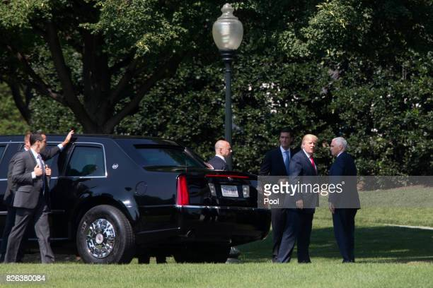 US President Donald Trump stands near the armored limousine known as 'The Beast' beside US Vice President Mike Pence upon returning from a visit to...