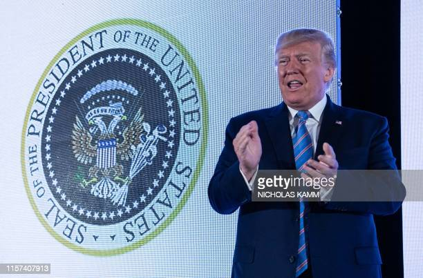 US President Donald Trump stands next to a surreptitiously altered presidential seal as he arrives to address the Turning Point USAs Teen Student...