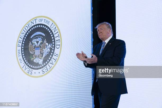 US President Donald Trump stands next to a surreptitiously altered presidential seal as he arrives on stage to speak during the Turning Point USA...