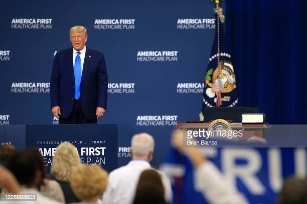 S President Donald Trump stands on stage after delivering remarks on his healthcare policies on September 24 2020 in Charlotte North Carolina Trump's...