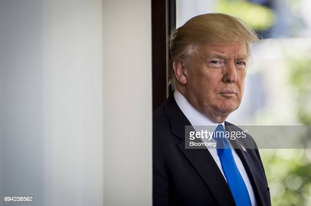 US President Donald Trump stands outside the West Wing of the White House as Klaus Iohannis Romania's president not pictured arrives at the West Wing...