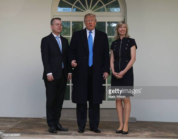 S President Donald Trump stands with American evangelical Christian preacher Andrew Brunson and his wife Norine Brunson before a meeting in the Oval...