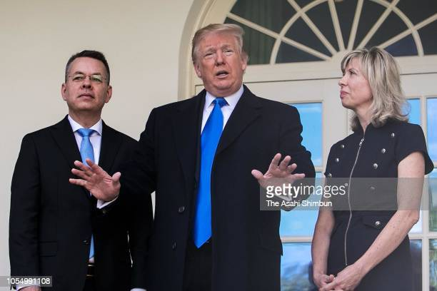 US President Donald Trump stands with American evangelical Christian preacher Andrew Brunson and his wife Norine Brunson before a meeting in the Oval...