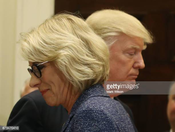S President Donald Trump stands with Education Secretary Betsy DeVosÊbefore signing the Education Federalism Executive Order that will pull the...