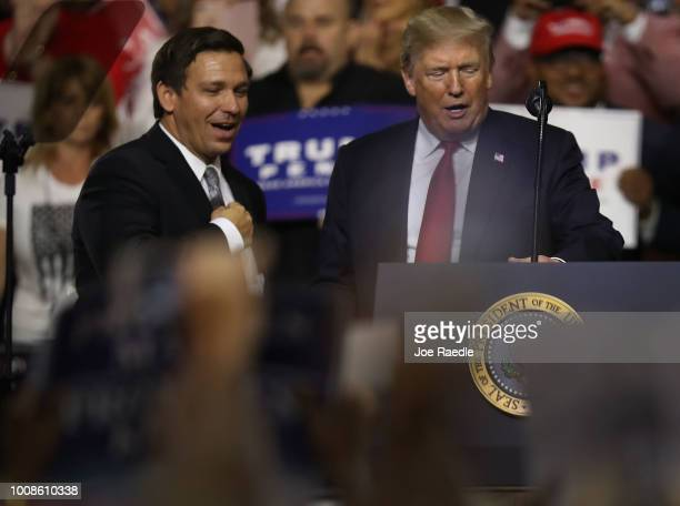 President Donald Trump stands with GOP Florida gubernatorial candidate Ron DeSantis during the president's Make America Great Again Rally at the...