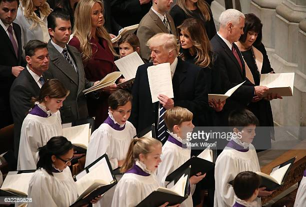S President Donald Trump stands with his wife first lady Melania Trump Vice President Mike Pence and his wife Karen Pence during the National Prayer...