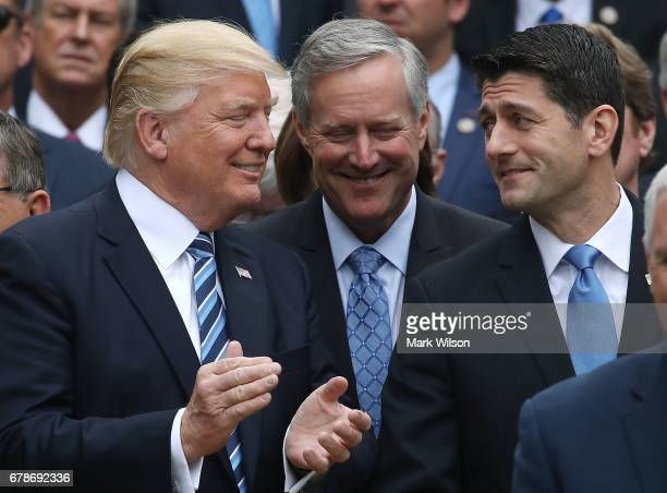 S President Donald Trump stands with House Speaker Paul Ryan and Freedom Caucus Chairman Mark Meadows after Republicans passed legislation aimed at...