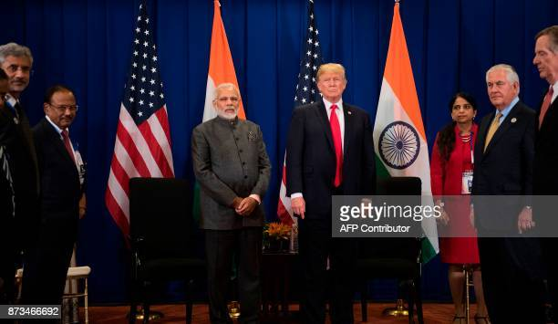 US President Donald Trump stands with Indian Prime Minister Narendra Modi during a bilateral meeting on the sideline of the 31st Association of...