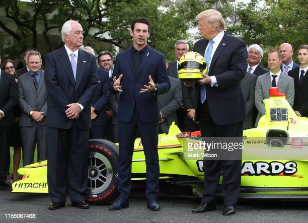 S President Donald Trump stands with Indianapolis 500 winner Simon Pagenaud and Team Penske owner Roger Penske during a ceremony to honor the driver...