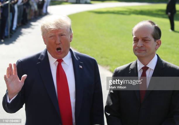 S President Donald Trump stands with Labor SecretaryAlex Acostawho announced his resignation while talking to the media at the White House on July...
