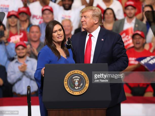 S President Donald Trump stands with Sarah Huckabee Sanders who announced that she is stepping down as the White House press secretary during his...