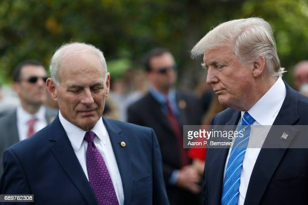 President Donald Trump stands with Secretary of Homeland Security John Kelly after laying flowers on the grave of Kelly's son First Lieutenant Robert...